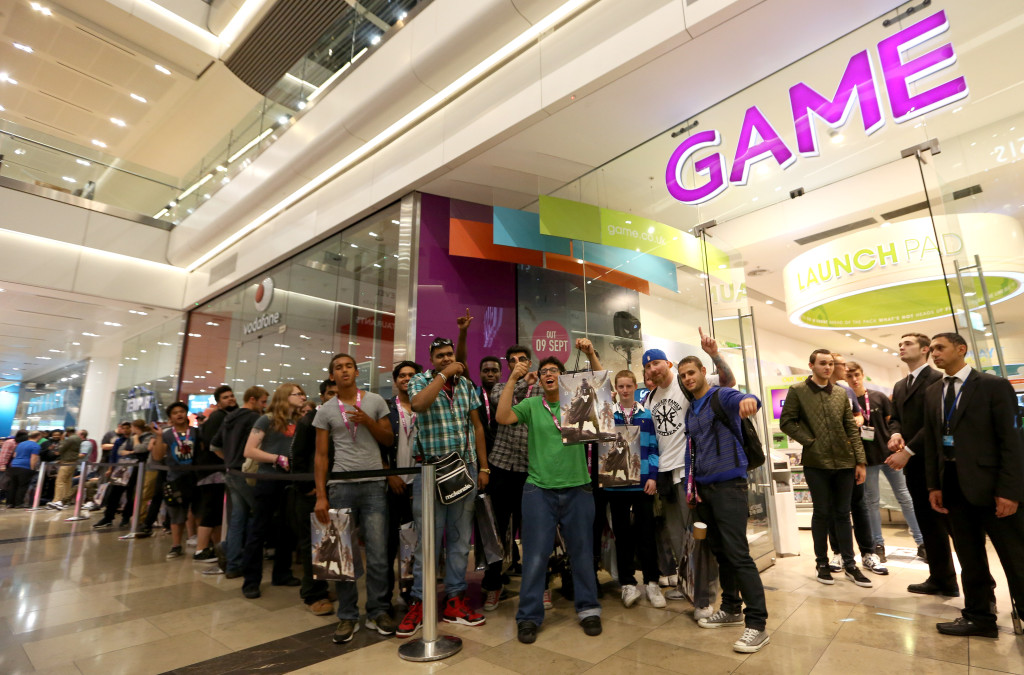 EDITORIAL USE ONLY Fans queue outside GAME Westfield Stratford City for the midnight release of Destiny, the latest game from the creators of Halo. PRESS ASSOCIATION Picture date:ÊMonday September 8, 2014. Photo credit should read: Matt Alexander/PA